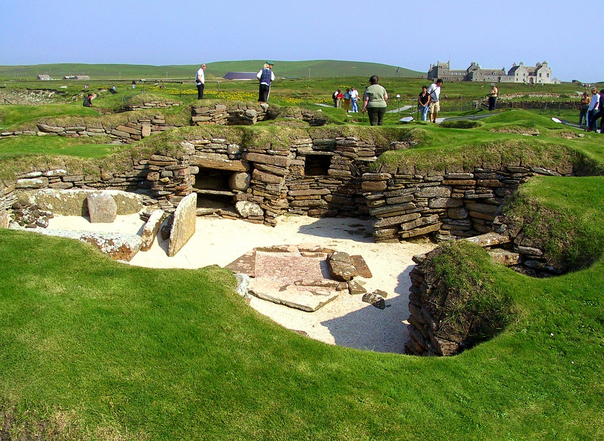 skara brae Skara brae is a stone-built neolithic settlement, located on the bay of skaill on the west coast of mainland, the largest island in the orkney archipelago of scotlandit consists of several clustered houses, and was occupied from roughly 3180 bce–2200 bce europe's most complete neolithic village, skara brae gained unesco world heritage .